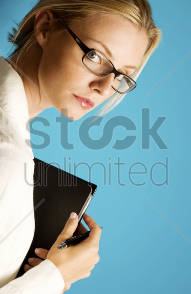 a bespectacled business woman stock photo
