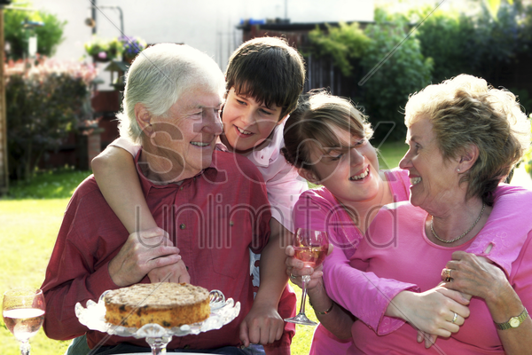 a boy and a girl celebrating their grandparents' wedding anniversary in the garden stock photo