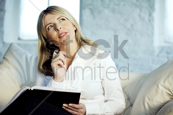 a business lady looking up and thinking stock photo