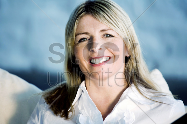 a business lady smiling at the camera stock photo