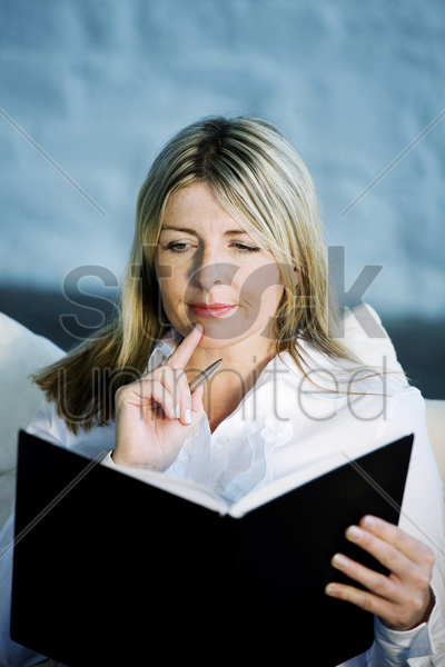 a business lady thinking for ideas stock photo