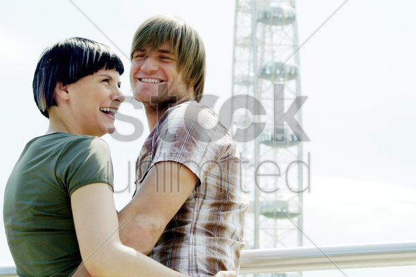 a couple at a funfair stock photo