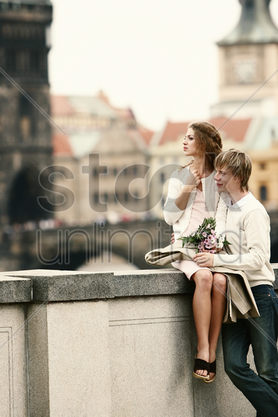 a couple enjoying the scenery together stock photo