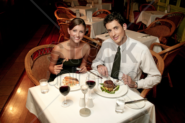 a couple in dinners wear celebrating their anniversary by eating in the restaurant stock photo