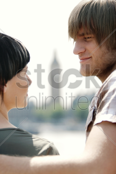 a couple looking at each other adoringly stock photo