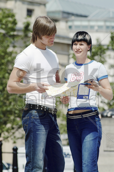 a couple referring to a map for directions stock photo