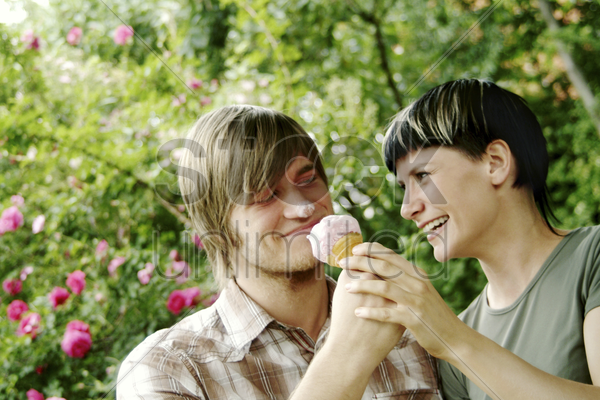 a couple sharing an ice-cream stock photo