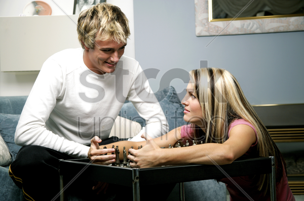 a frustrated lady covering the chess after she lost in the game stock photo