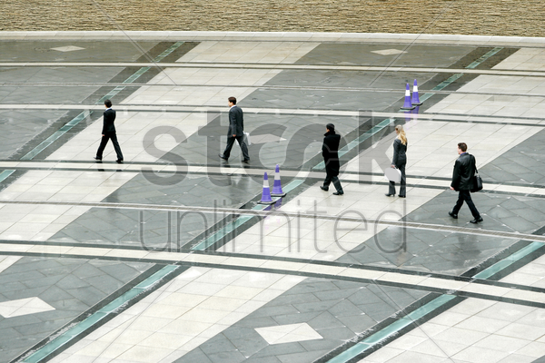a group of business people heading to their office stock photo