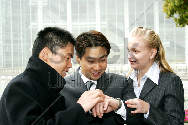 a group of business people looking at the time stock photo