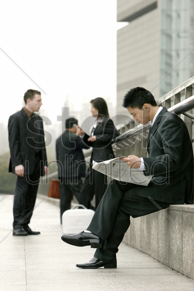a group of working people in business suit waiting by the road side stock photo