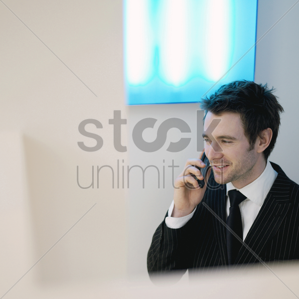 a guy in suit using cell phone stock photo