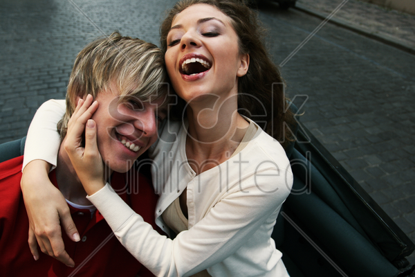 a guy lying happily on his girlfriend's shoulder stock photo