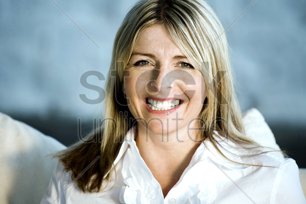 a happy business lady looking at the camera stock photo