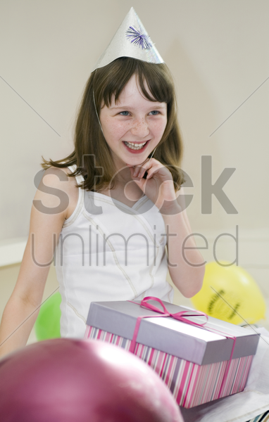 a happy girl in her birthday party stock photo