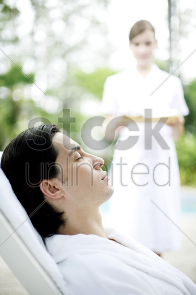 a lady walking towards a man stock photo