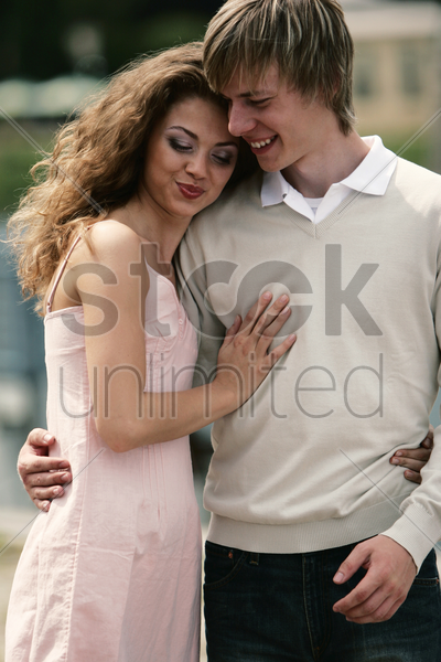 a loving couple standing close to each other stock photo