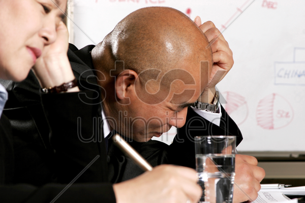 a man and a woman having a stressful time stock photo