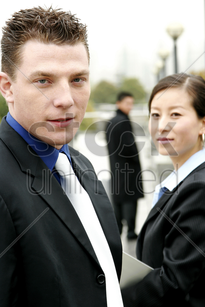 a man and a woman in office attire stock photo