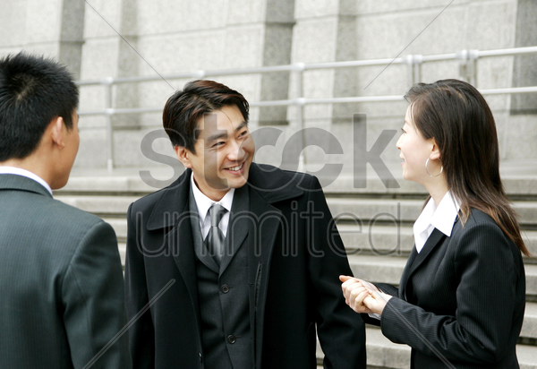 a man and a woman talking stock photo