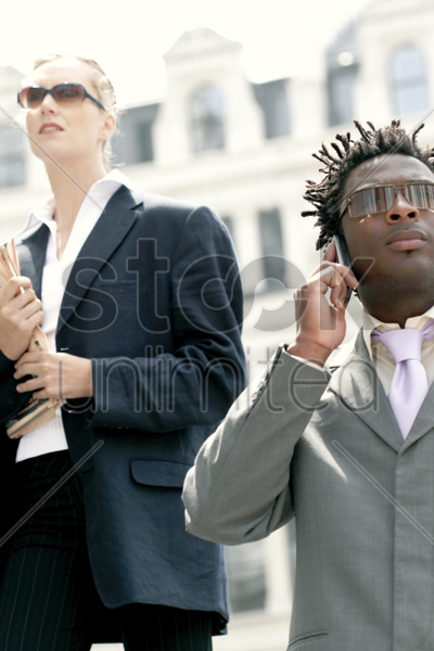 a man and a woman wearing sunglasses stock photo