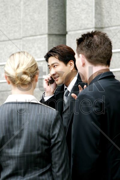 a man busy talking on the hand phone stock photo