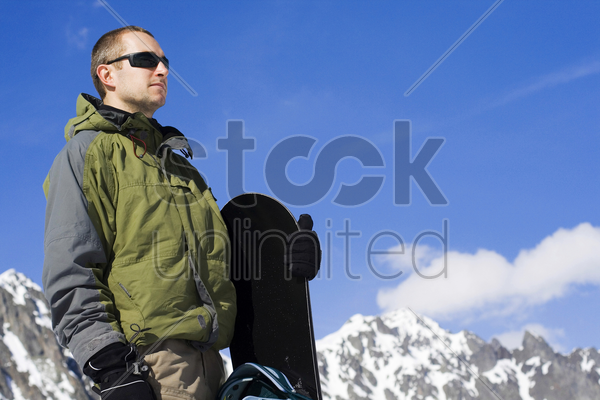 a man holding snowboard stock photo