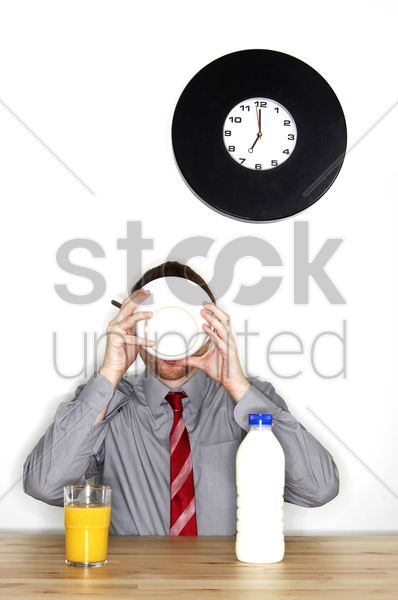 a man in office attire having his breakfast stock photo