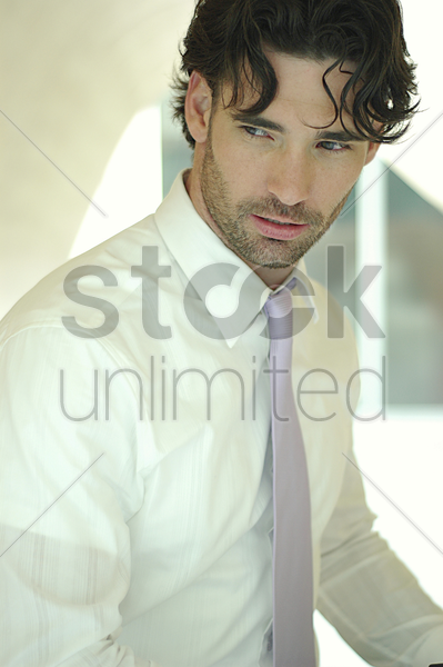 a man in white long sleeve shirt and tie stock photo