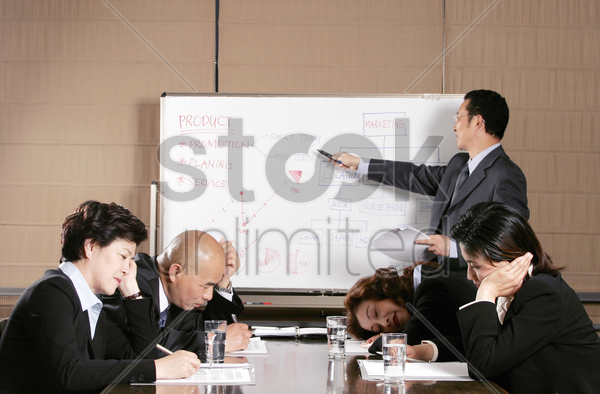 a man teaching while the others sleeping stock photo