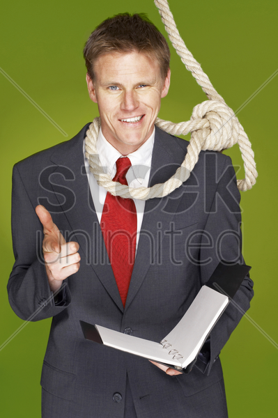 a man with rope hanging around his neck showing a hand gun stock photo