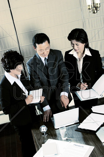 a manager explaining things using the laptop stock photo