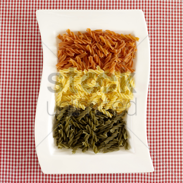 a plate of colourful pasta stock photo
