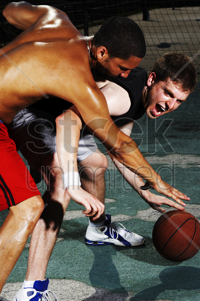 a player trying to snatch the ball from his opponent stock photo