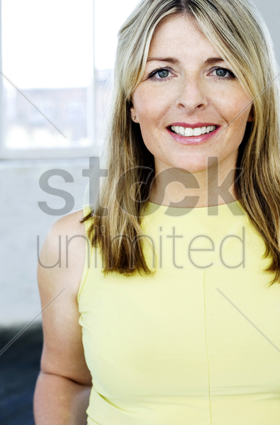 a portrait of a lady wearing yellow singlet stock photo