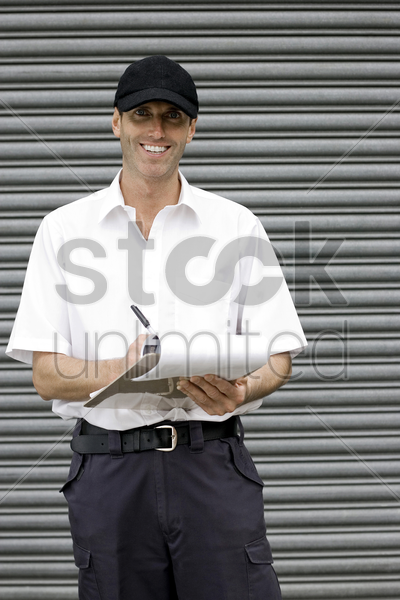 a postal service supervisor compiling data stock photo