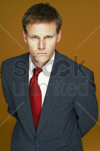 a serious looking man in business suit stock photo