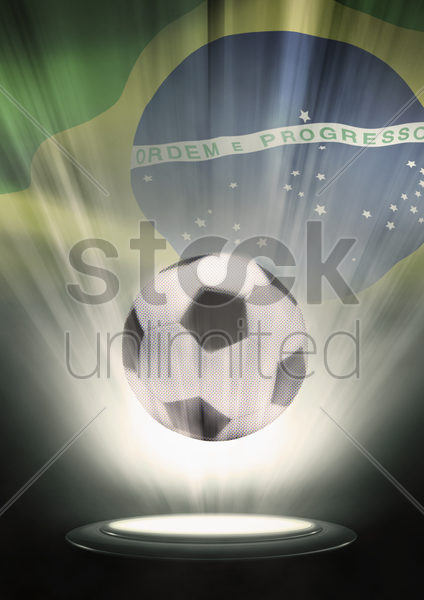 a soccer ball with brazil flag backdrop stock photo