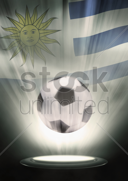 a soccer ball with uruguay flag backdrop stock photo