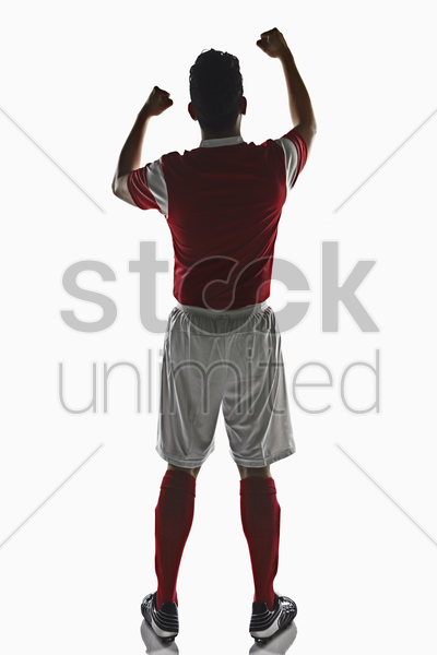 a soccer player cheering stock photo