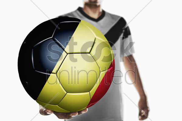 a soccer player holding belgium soccer ball stock photo