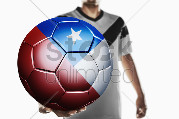 a soccer player holding chile soccer ball stock photo