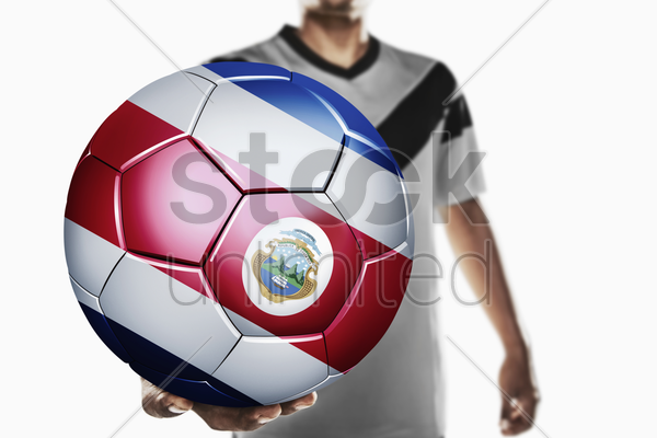a soccer player holding costa rica soccer ball stock photo