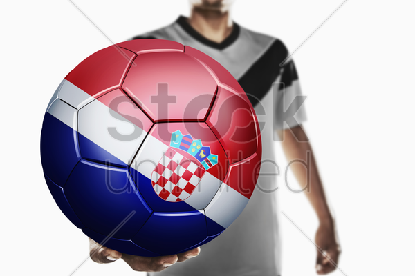 a soccer player holding croatia soccer ball stock photo