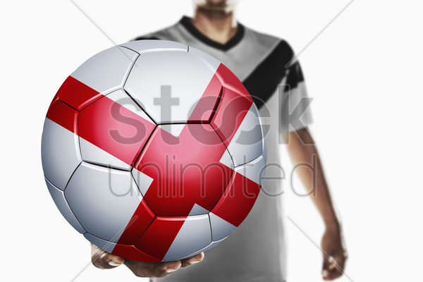a soccer player holding england soccer ball stock photo