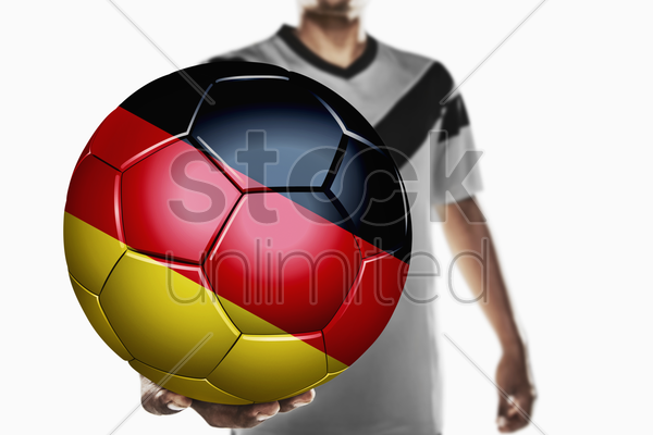 a soccer player holding germany soccer ball stock photo