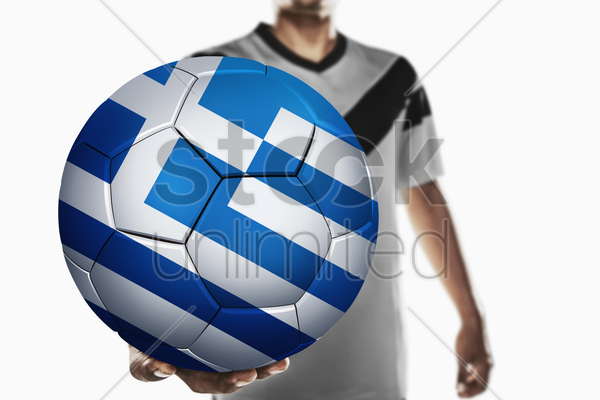 a soccer player holding greece soccer ball stock photo