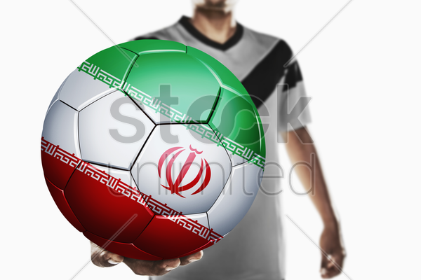 a soccer player holding iran soccer ball stock photo