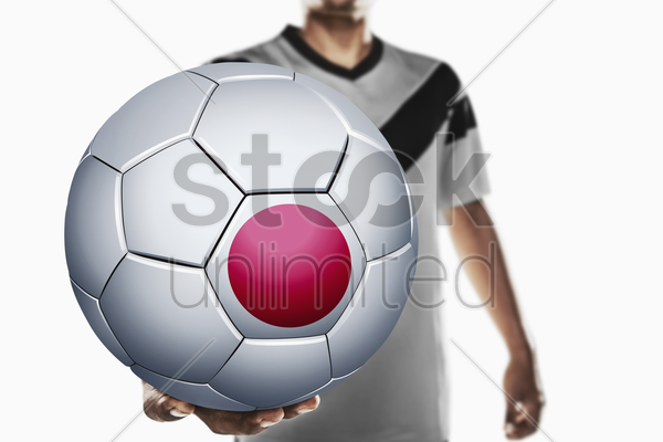 a soccer player holding japan soccer ball stock photo