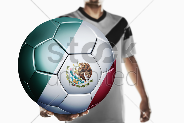 a soccer player holding mexico soccer ball stock photo